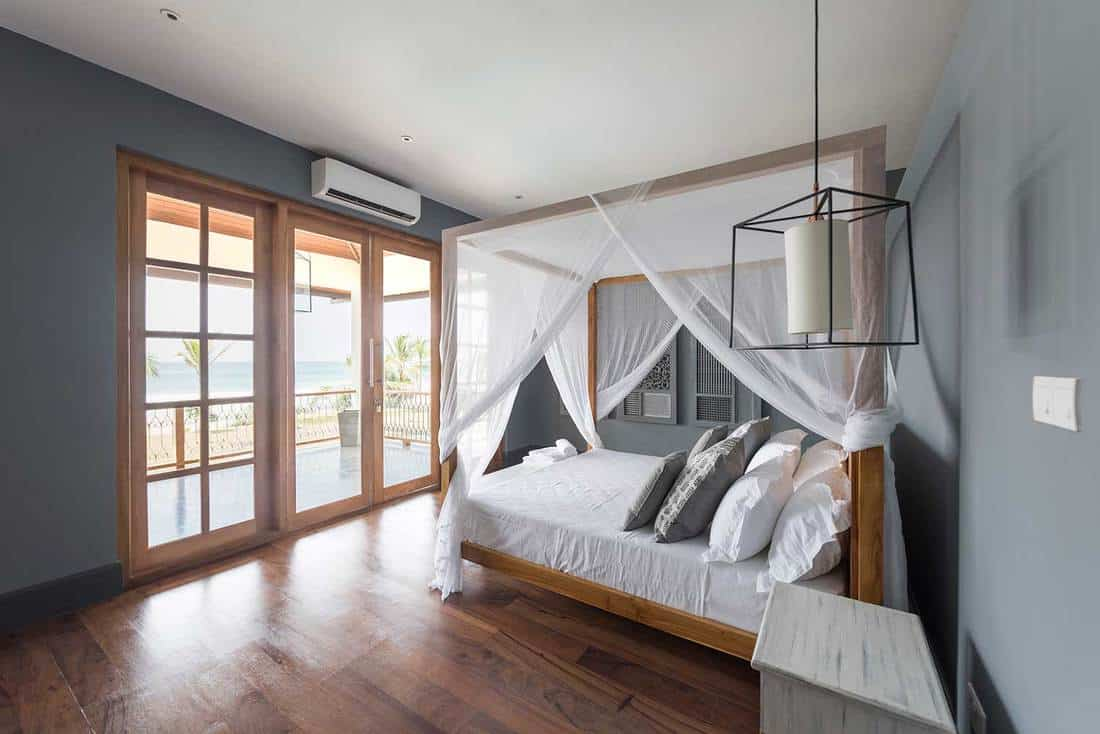 Modern beach side hotel room with wooden carpet flooring