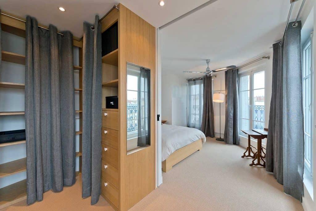 Modern bedroom interior with empty wardrobe