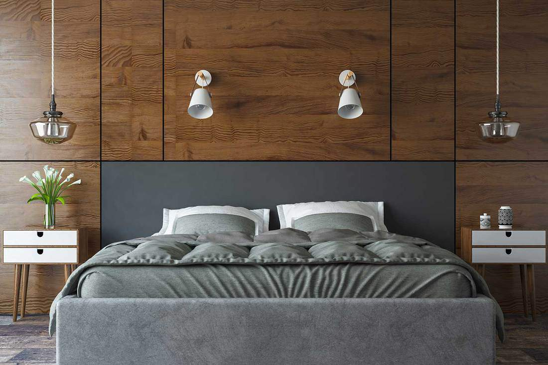 Modern bedroom with grey bed and wooden interior