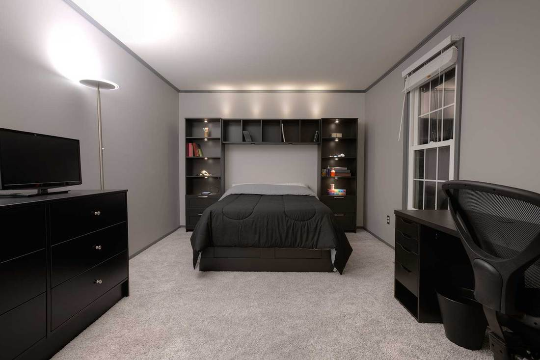 Modern bedroom with grey carpet flooring