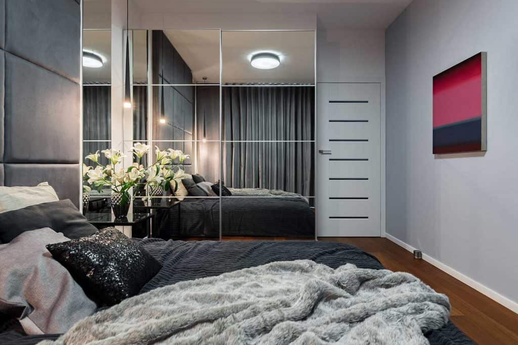 Modern bedroom with mirrored wardrobe
