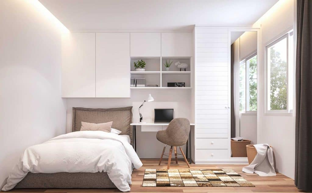Modern bedroom with office table and window