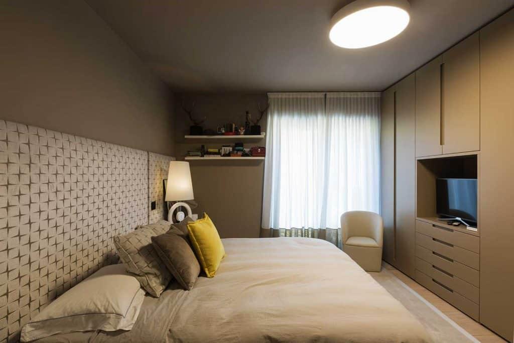 Modern brown bedroom with wardrobe
