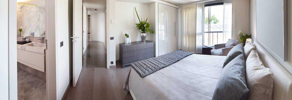 Modern cozy white bedroom with balcony