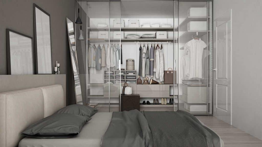 Modern grey bedroom with walk-in closet