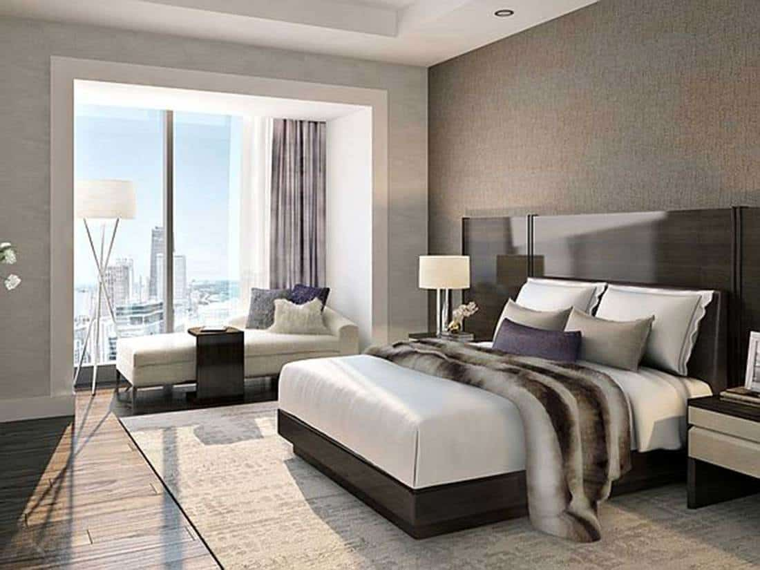 Modern hotel bedroom with city view