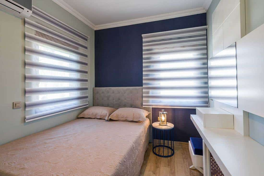 Modern hotel bedroom with lamp