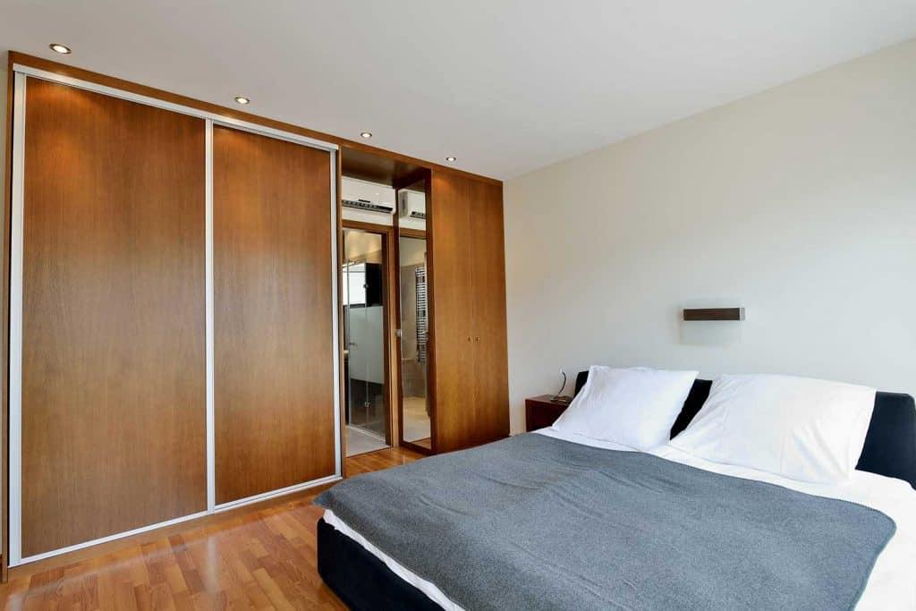Modern hotel bedroom with wardrobe