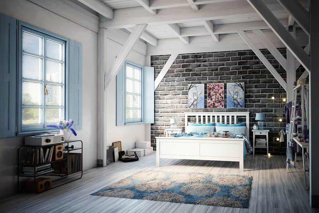 Modern light blue bedroom in a wooden house