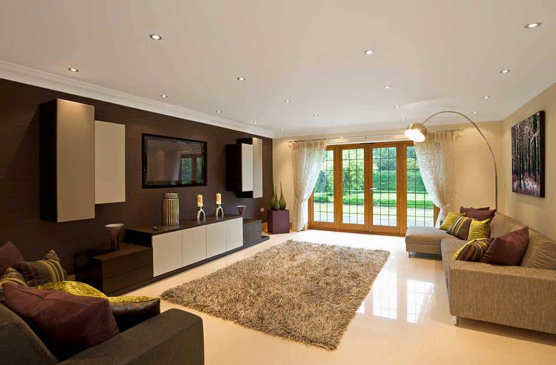 Modern living room space with carpet and tv