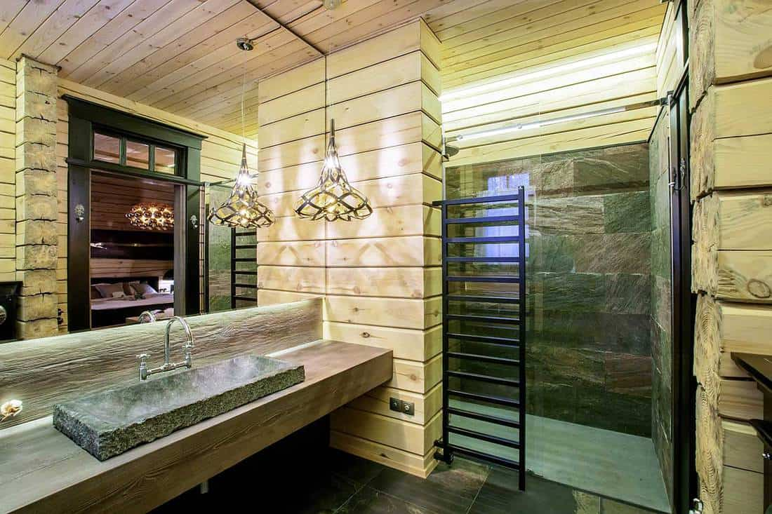 Modern rustic bathroom with classy interior and stone counter top washbasin