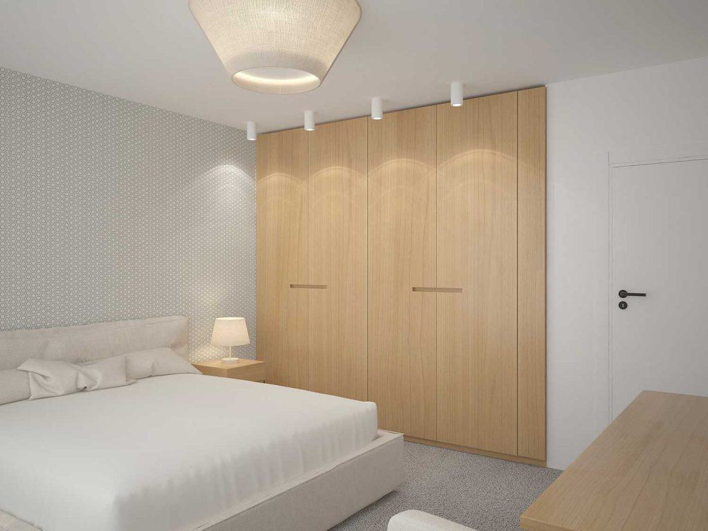 Modern white hotel bedroom with closet