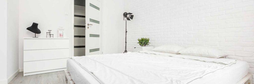 Monochromatic white bedroom