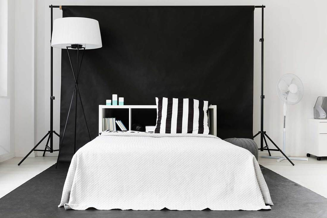 New black and white bedroom in creative style with large bed