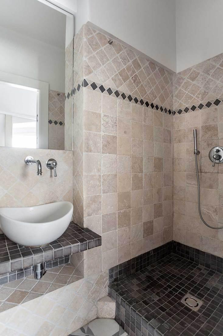 Rustic bathroom with tile interior