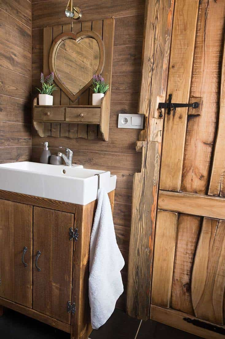 Rustic wooden bathroom in a cabin