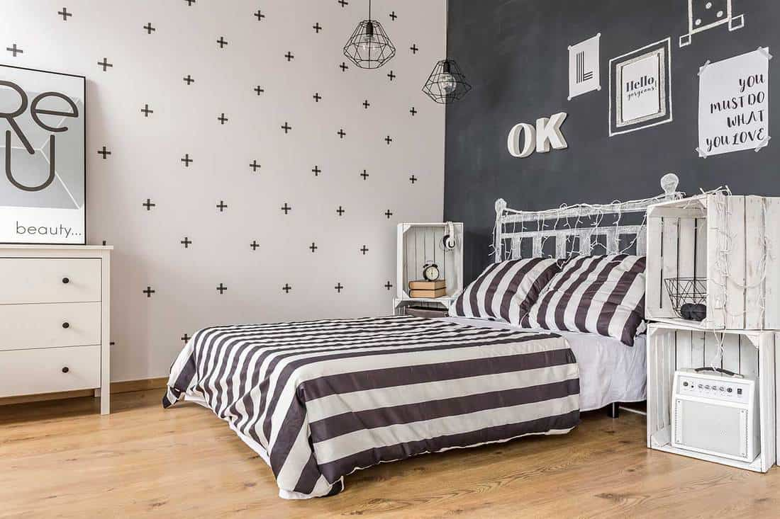Shot of a bed in a modern black and white bedroom