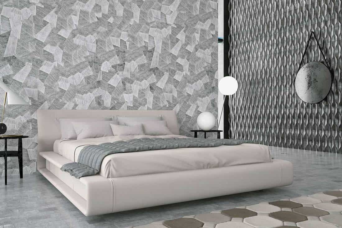 Stylish grey themed bedroom with patterned walls and flooring