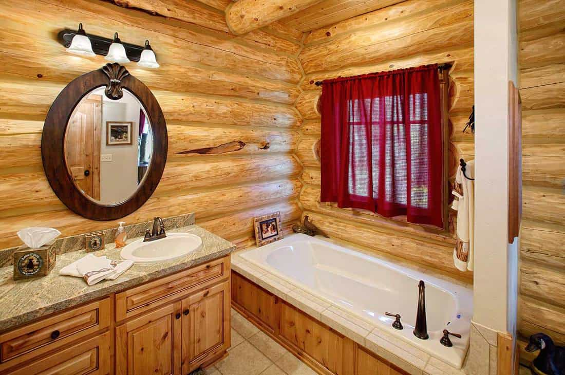The bath room in a rustic log cabin, in the mountains