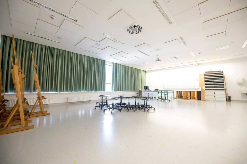Large conference room with green curtains