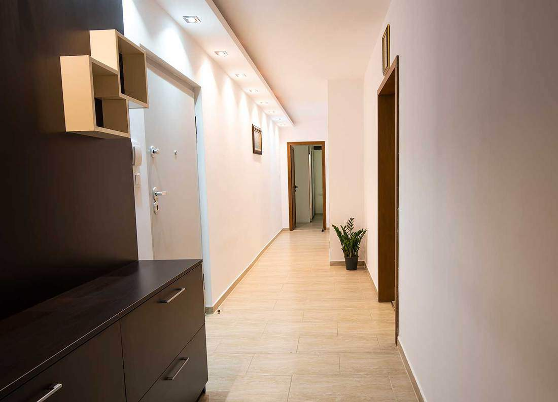 A long corridor with lights in an apartment entrance