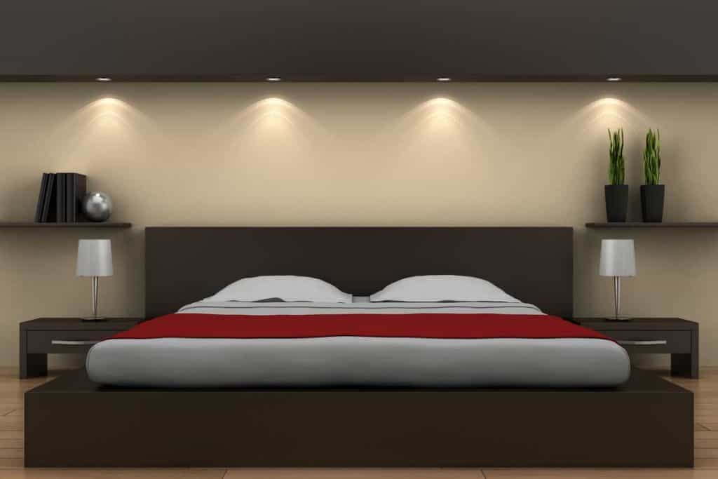 King-size bed in between lamps in a modern bedroom