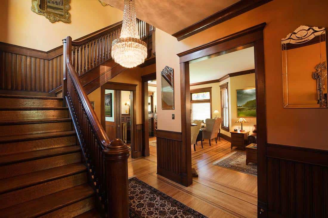 Entryway foyer and staircase of restored renovated victorian home interior