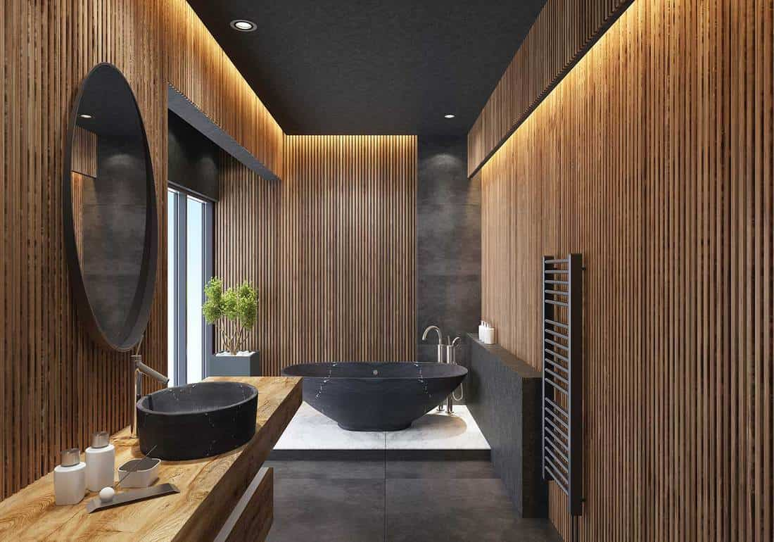 Luxurious minimalist bathroom with wooden striped walls