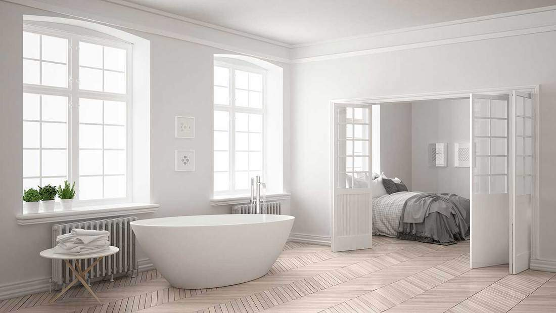 Minimalist scandinavian white bathroom with bedroom in the background