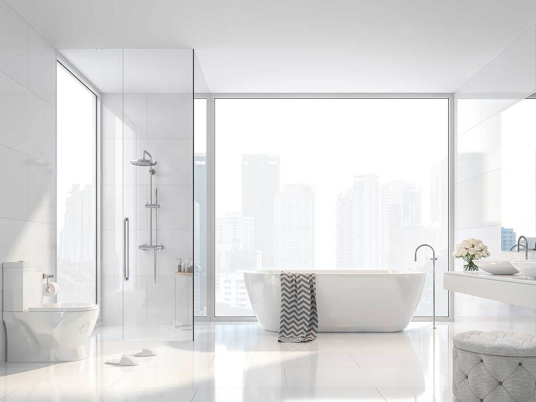 Modern white bathroom with city view