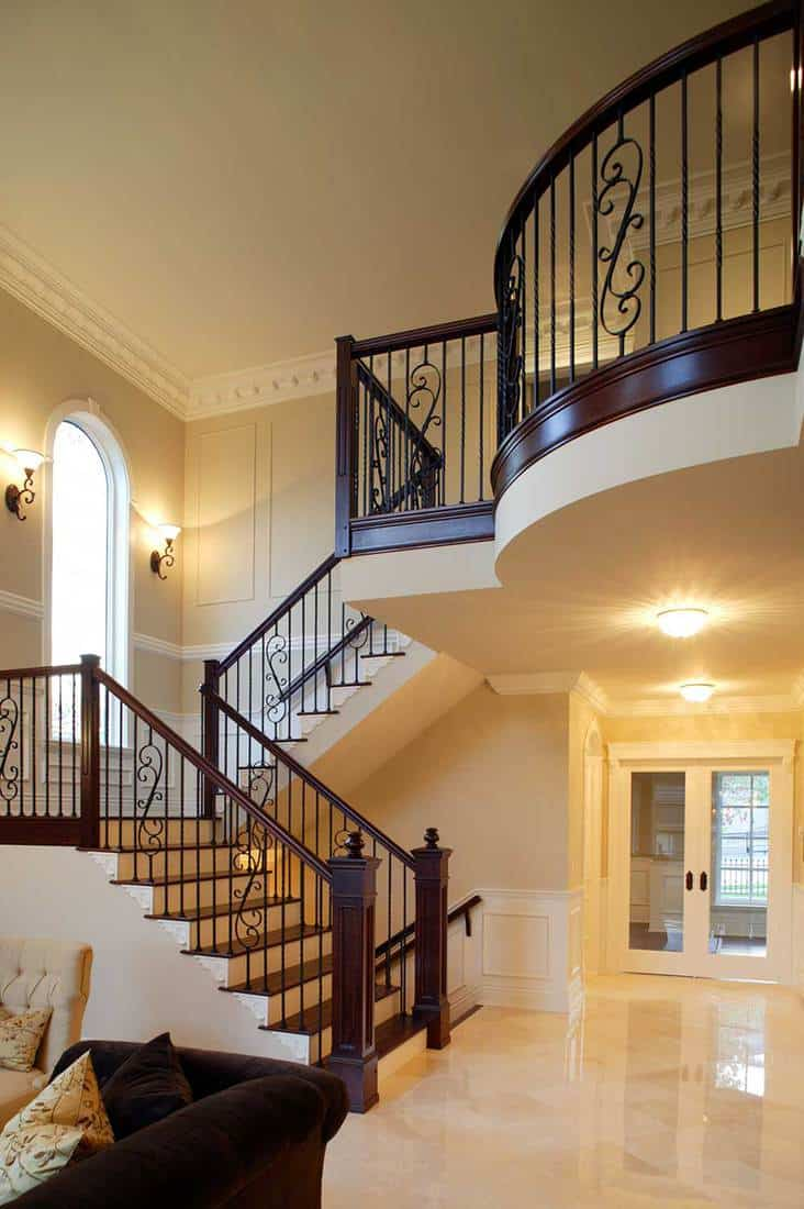 Staircase wrought iron hand rail luxury estate mansion home interior