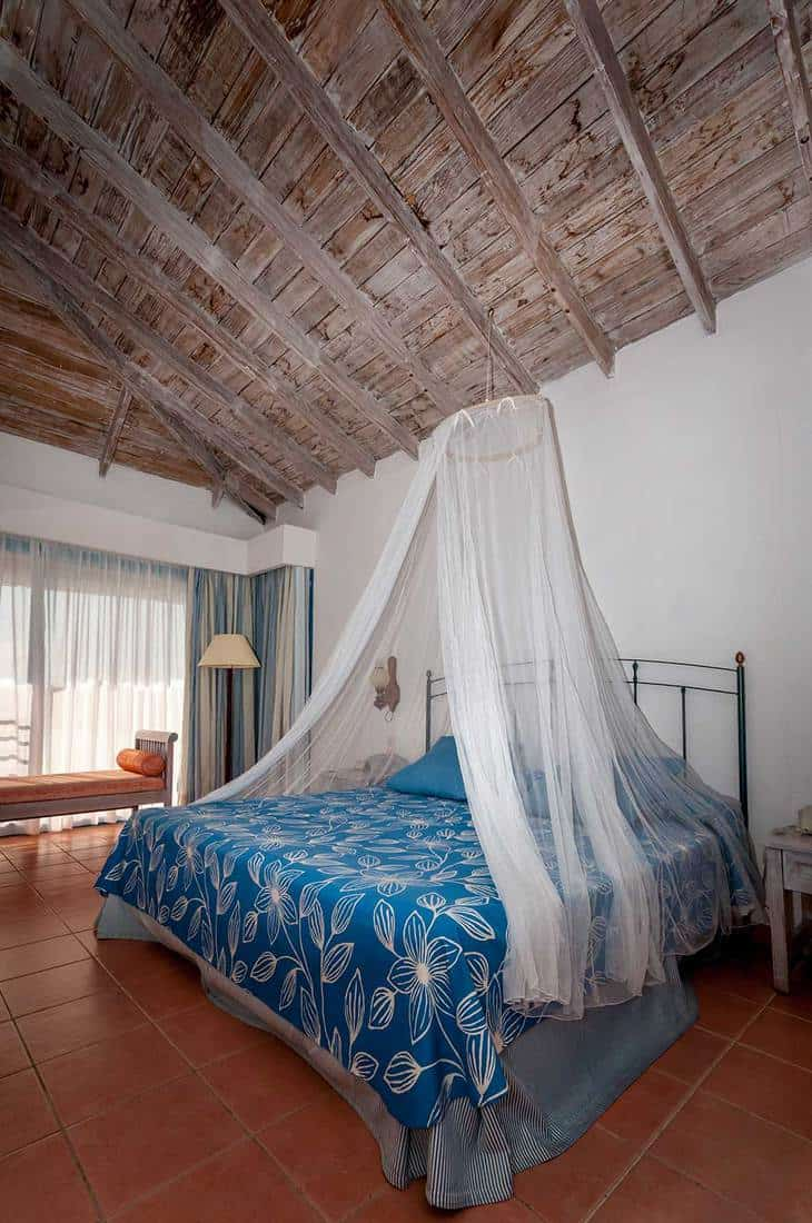 Tropical theme bedroom with wooden ceiling