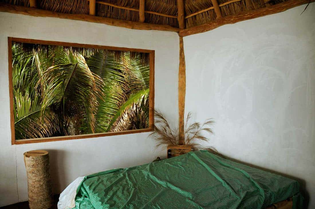 View through the window of tropical cottage room