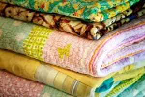 What Is the Difference Between a Comforter and Blanket?