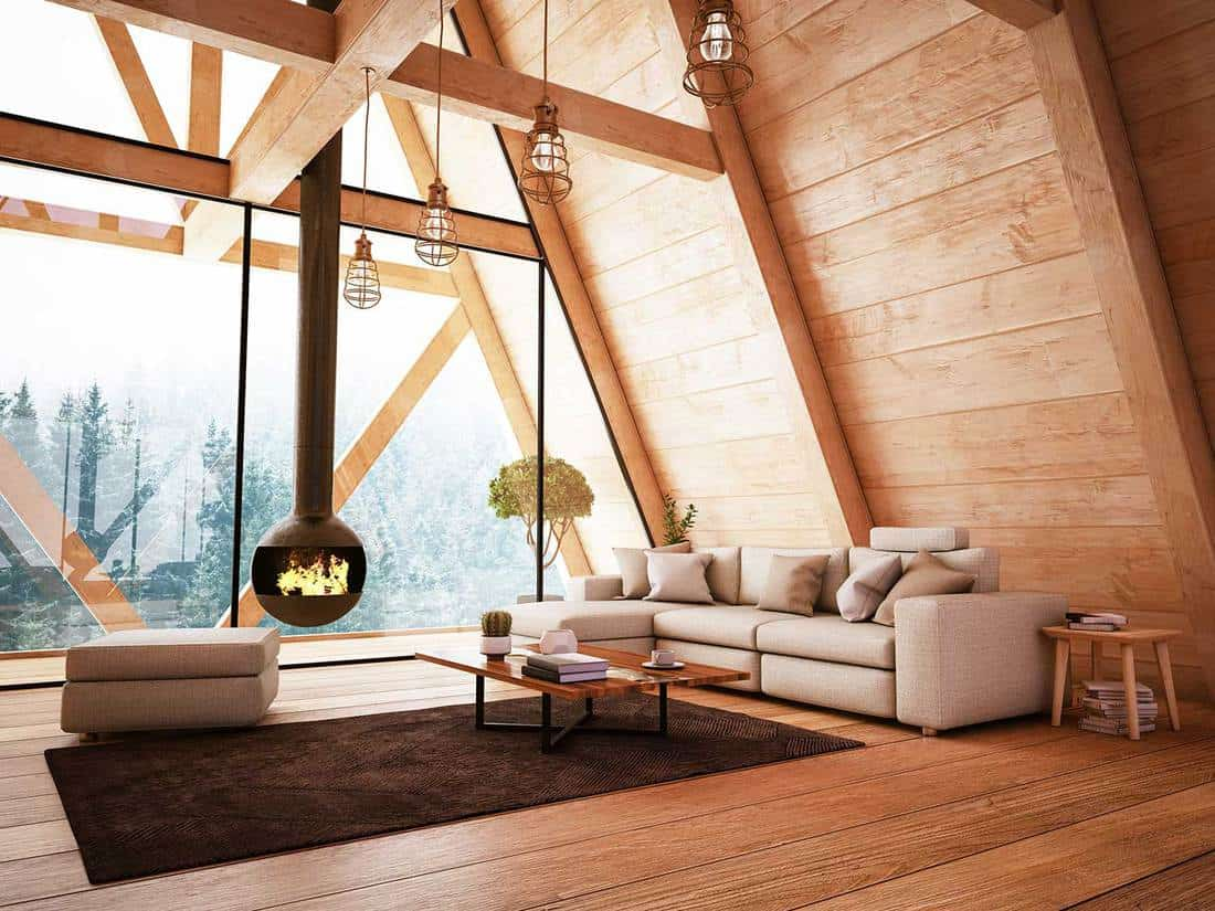 Attic living room in a modern wooden house