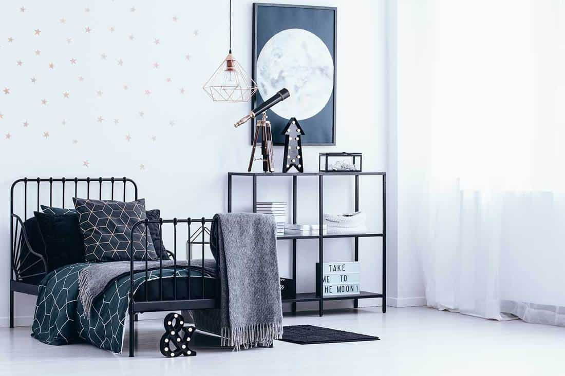 Black and white bedroom with industrial style light