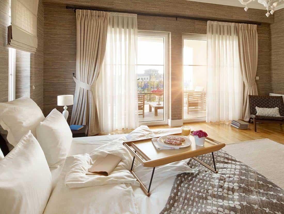 Breakfast in a cozy modern bedroom