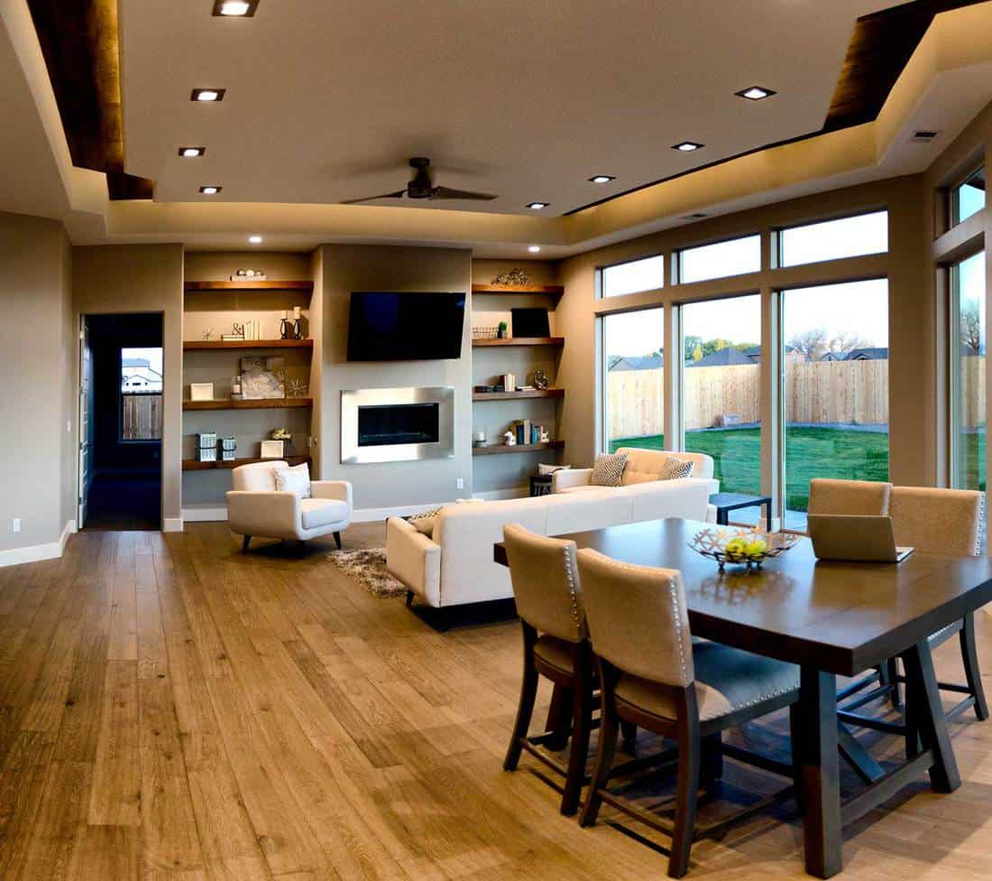 Comfortable home interior with parquet flooring, dining table and living room