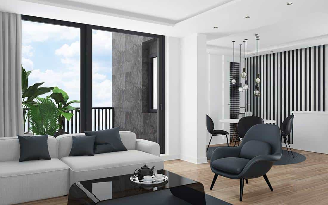 Cozy and modern small apartment design living room with dining room