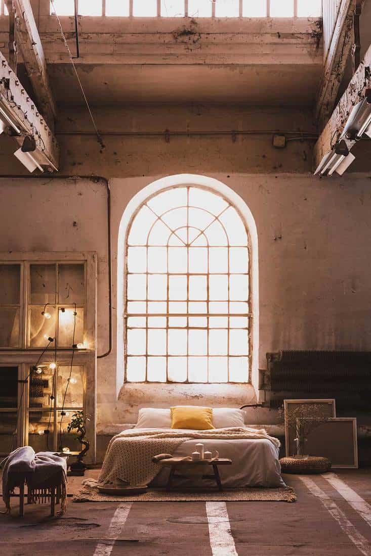 Cozy industrial style bedroom interior