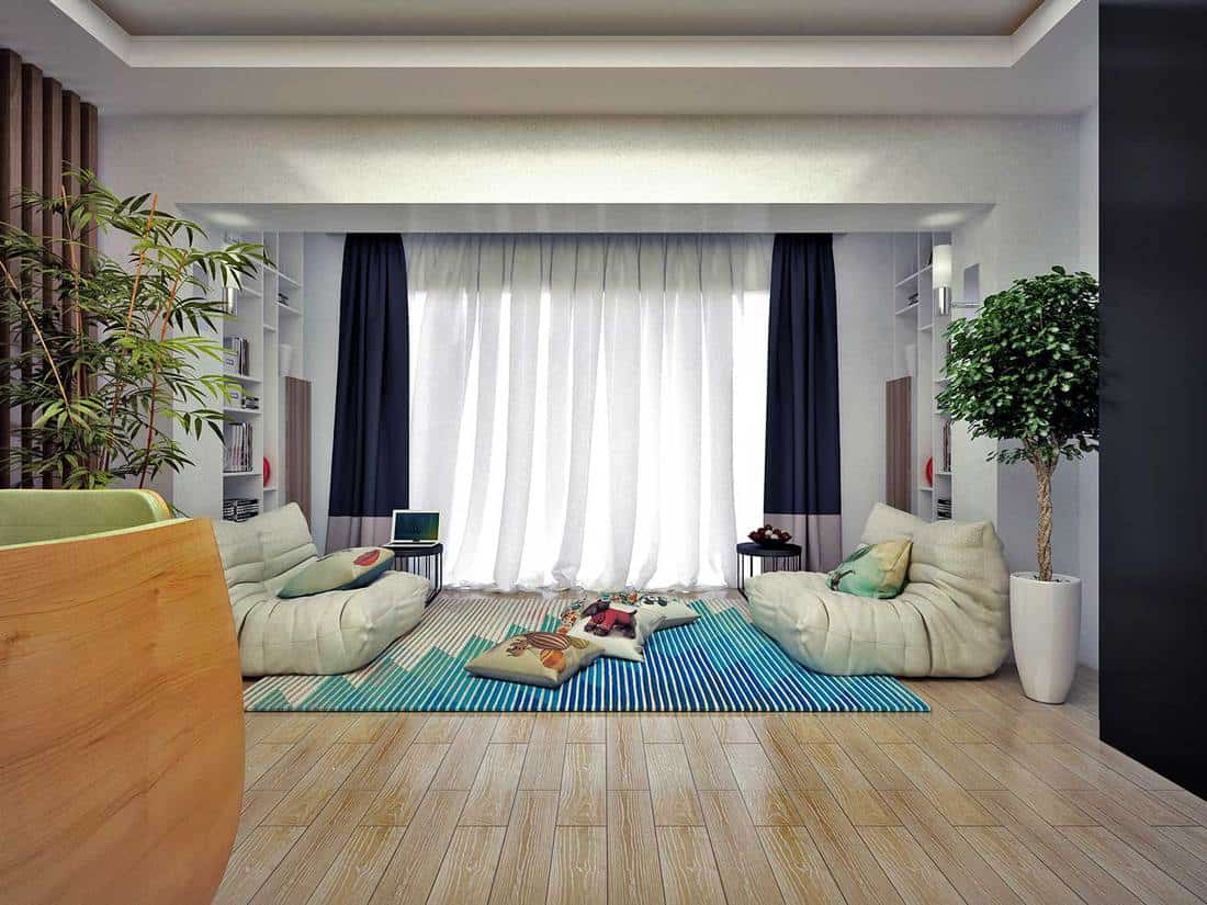 Cozy living room with parquet flooring and house plant