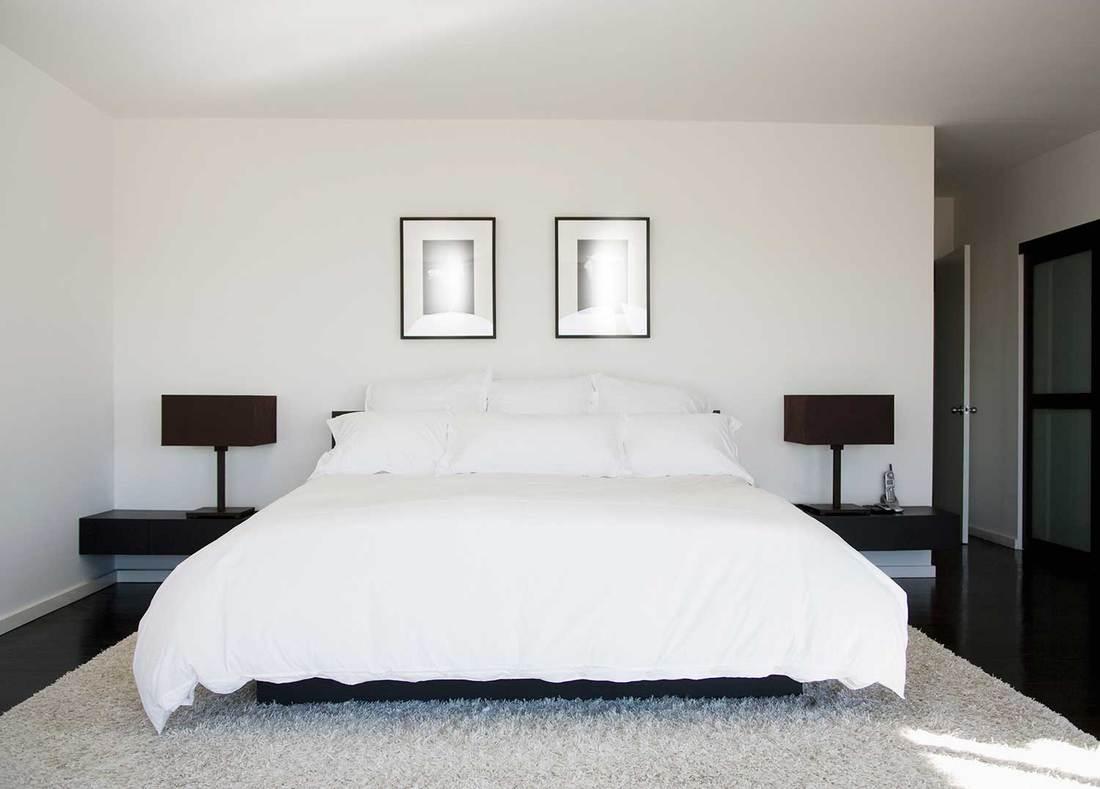 Cozy minimalist hotel bedroom