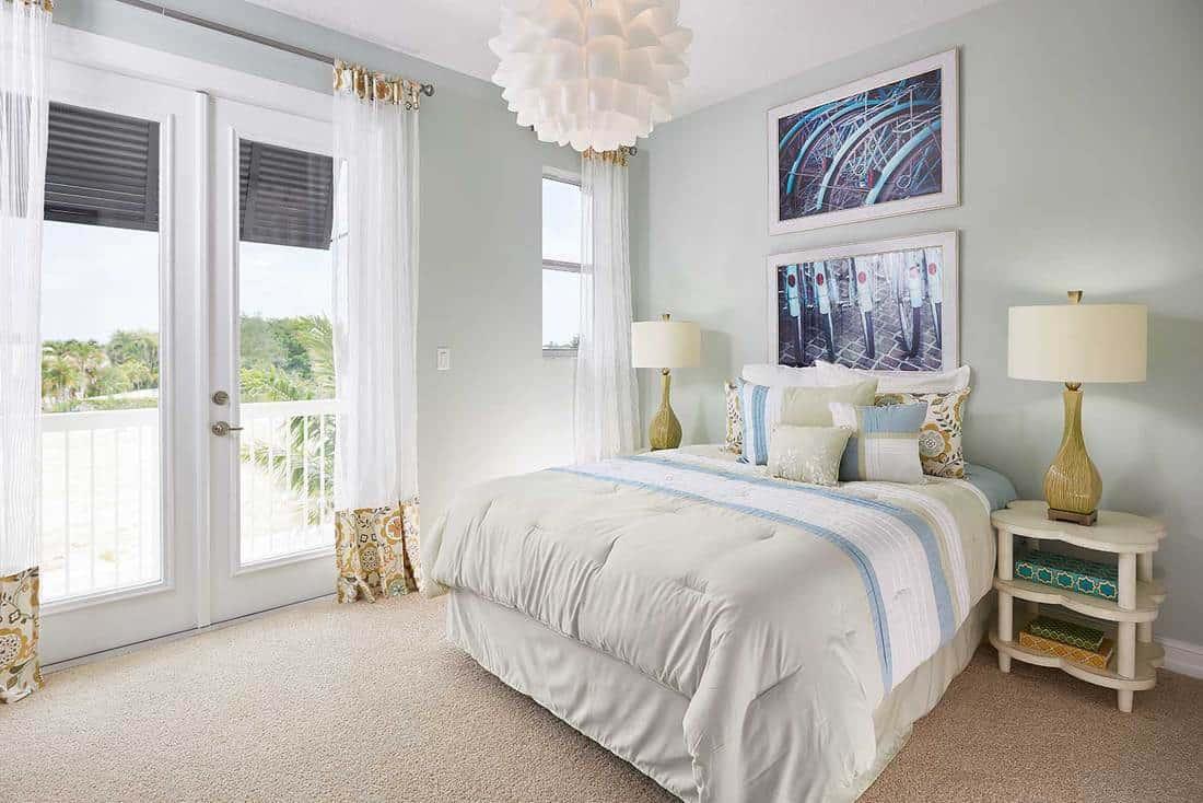 Cozy white bedroom overlooking sea