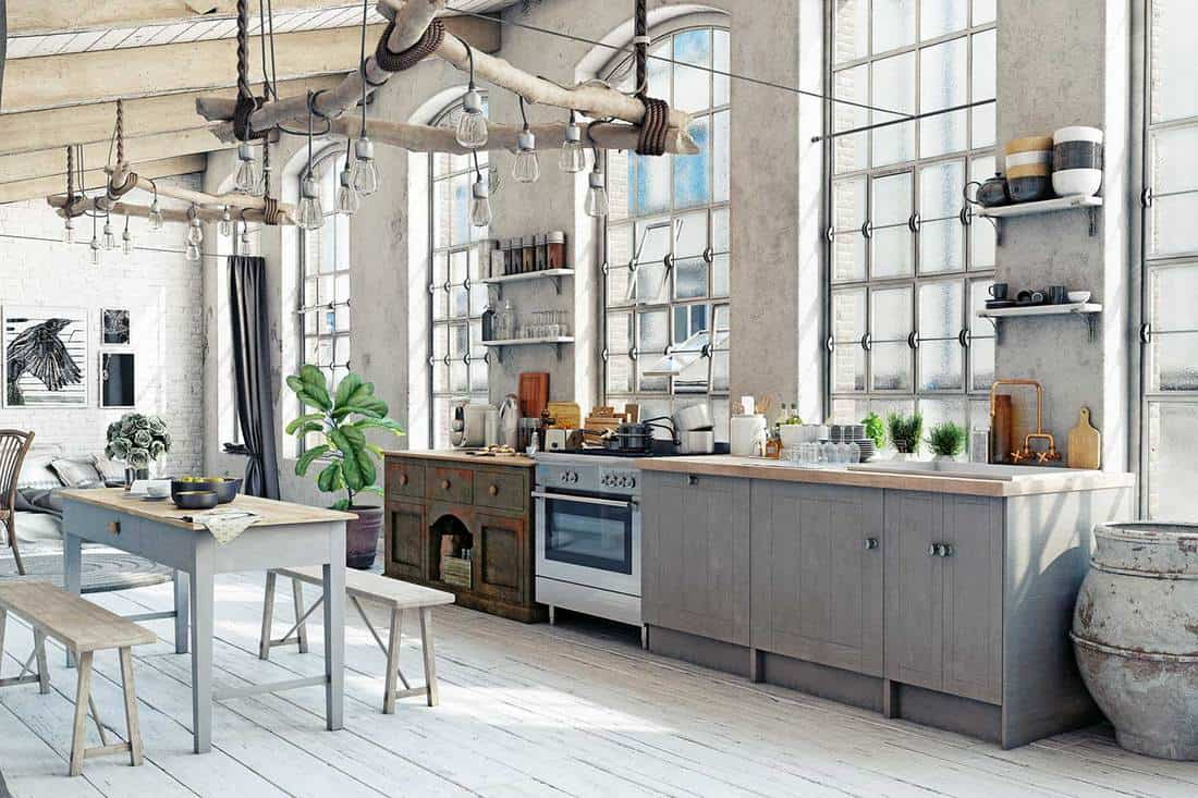 Industrial style attic loft kitchen interior with hardwood floor, tables and chair