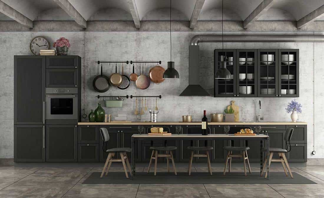 Industrial style black kitchen in a grunge interior with dining table