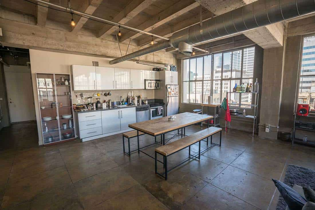Industrial style loft apartment kitchen with city view