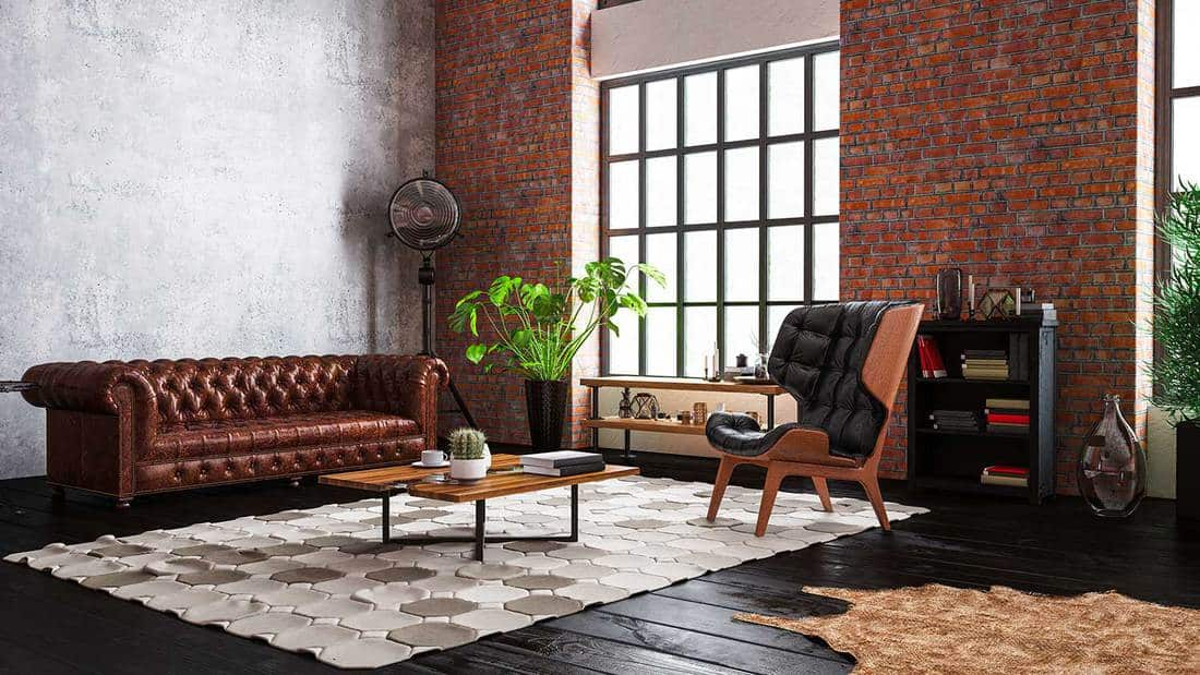 Industrial style loft apartment living room with brick wall and wood flooring