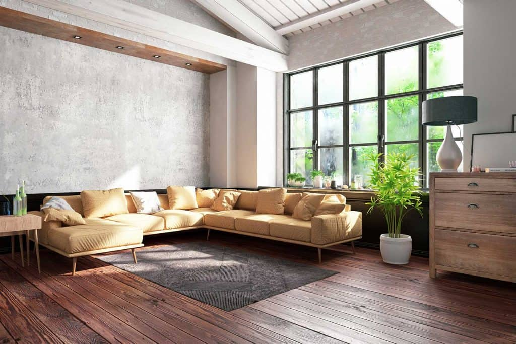 Industrial style loft apartment living room with wood flooring