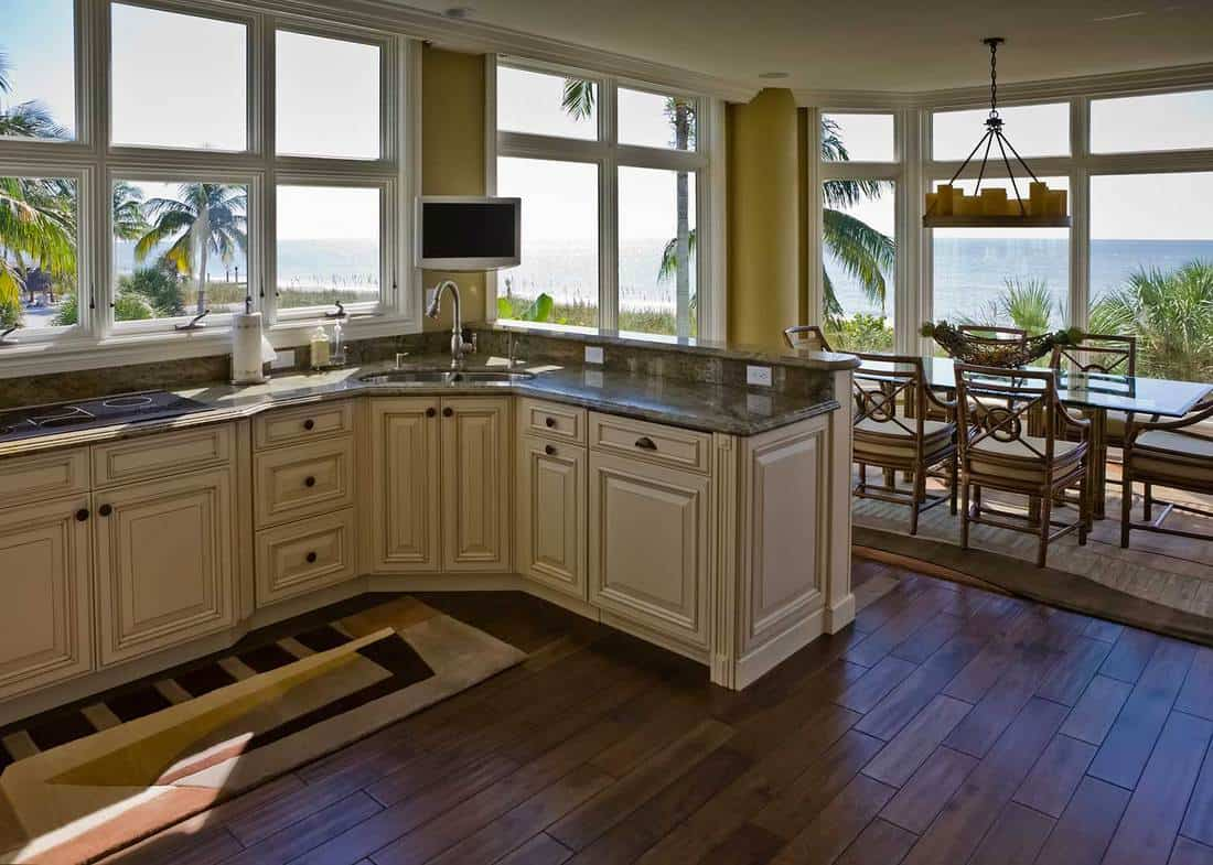 Interior of a beach house kitchen with sea view