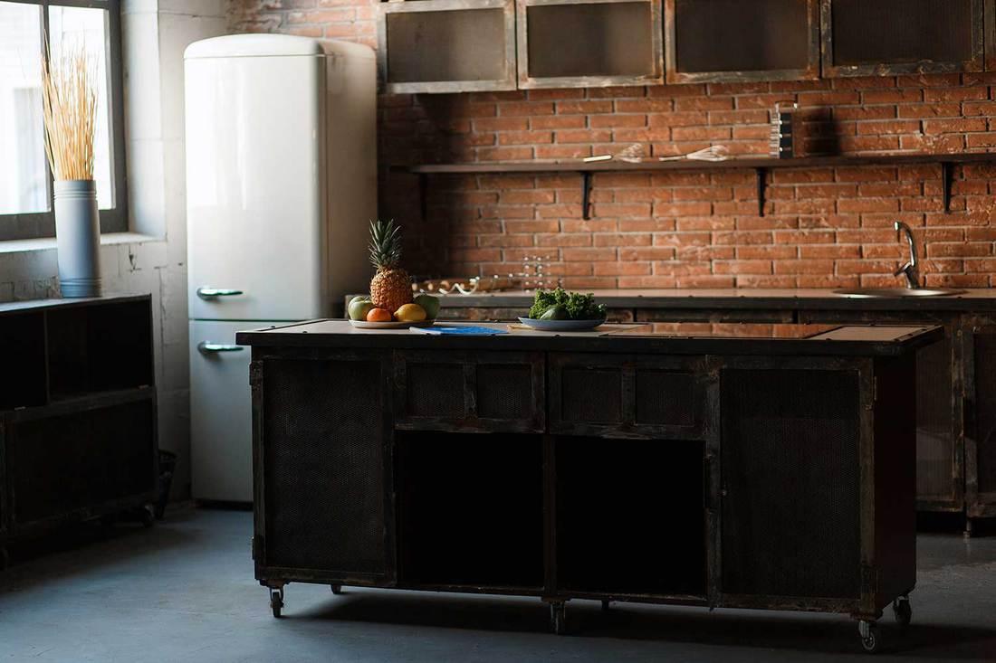 Loft kitchen with brick wall